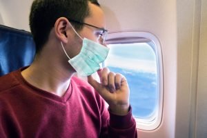 face mask on plane